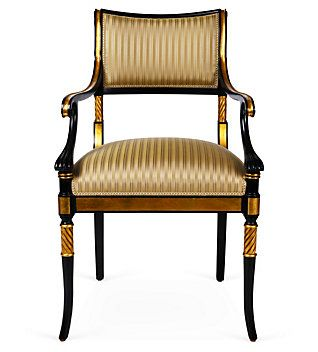 An Empire-style armchair with gilt and swept, scrolled arms. A neo-classical style with elements of Louis XVI and Directoire styels. This style was established during Napoleon's rule, in which, he had extravagant taste and passion in bringing the past to life.
