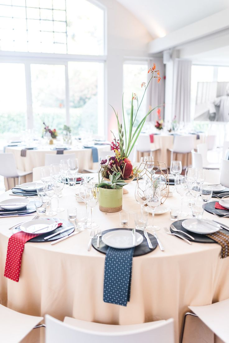 Event Design: Peach table cloths complimented our rose gold accessories well. We then layered the place settings with a black wooden base plate, shwe-shwe fabric napkins and handmade ceramic side plates. Gorgeous wedding decor!