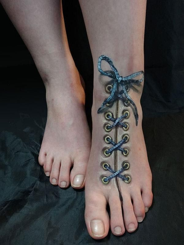 Top 28 3D Tattoos Guaranteed to Blow Your Mind - No need to tie Shoelaces  The woman's tattoo on her feet gives us the impression that she isn't a big fan of tying shoelaces. Nonetheless, the tat is beautifully done and anyone with a fetish for tattoos will be vastly attract