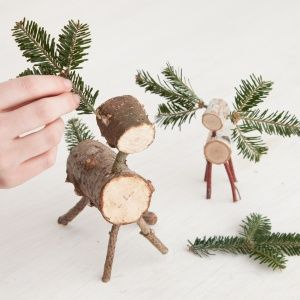 How to make Christmas tree reindeer from fallen birch branches or firewood logs. Adorable.