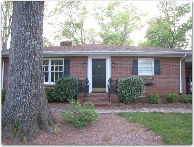Brick Ranch- Black Door and Shutters and White Trim