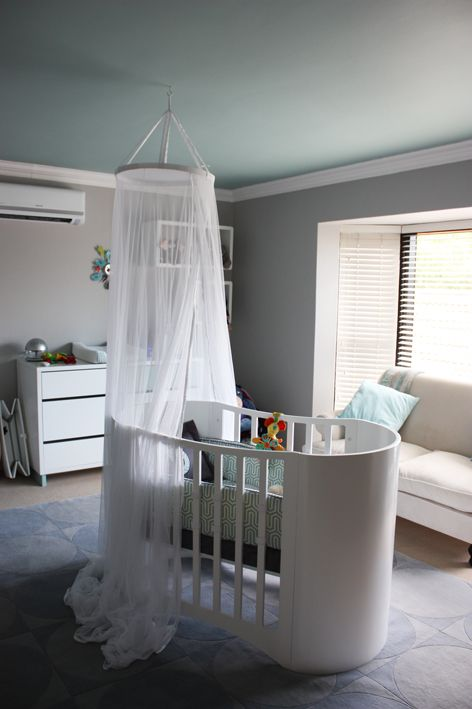 This modern gray nursery features a blue ceiling. So unexpected, but so great!: Baby Cot, Nursery Ceiling, Modern Gray, Blue Nursery, Ceiling Curtain, Baby Boy, Gray Nursery, Gray Nurseries
