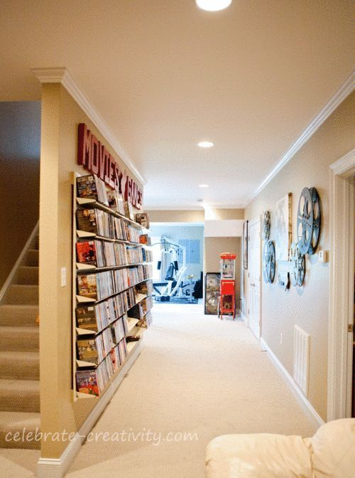 DVD library wall- cool idea for a basement! But I would want it in a glass enclosure so they dont get dusty