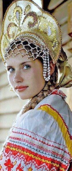 Girl wears a stylized kokoshnik, Russian traditional headdress.