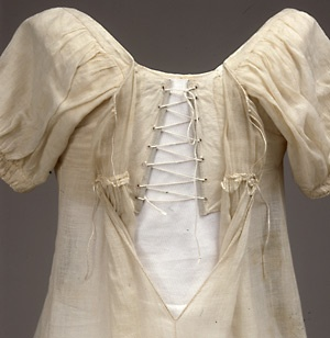 1817 Danish dress. After the under dress laces, there are two ties to hold the outerdress closed.