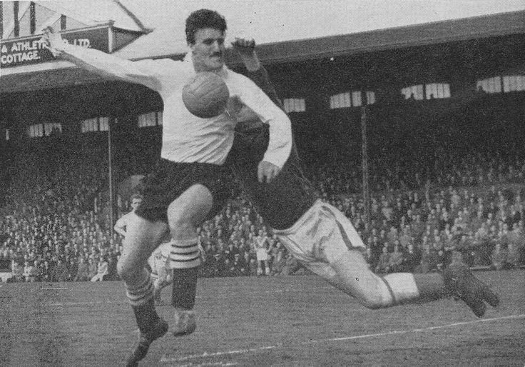 13th December 1958. Charlton Athletic goalkeeper Willie Duff makes a fly leap but Fulham half back Jimmy Hill wins the ball, at Craven Cottage.