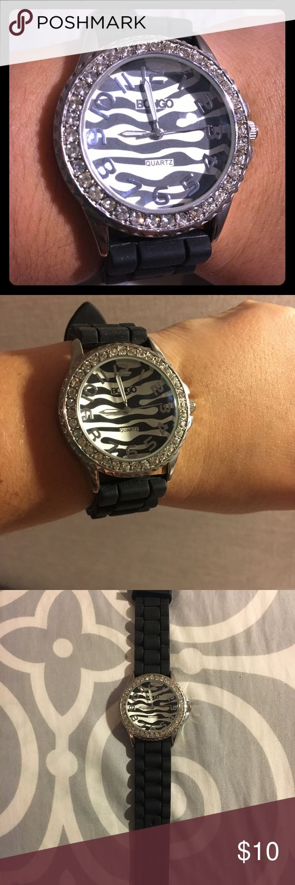 Bongo watch Bongo watch. Black rubber band that's super comfortable. Multiple adjustment settings, fits just about any size women's wrist. May need a new battery, but is otherwise in perfect condition. Only worn a handful of times, no scratches. BONGO Accessories Watches