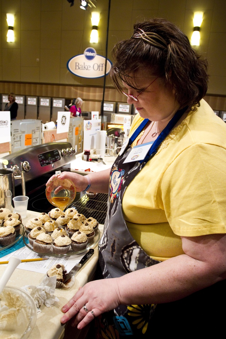 Lori Falce puts some finishing touches on Spiced Chocolate Cupcakes with Caramel Buttercream. #BakeOff