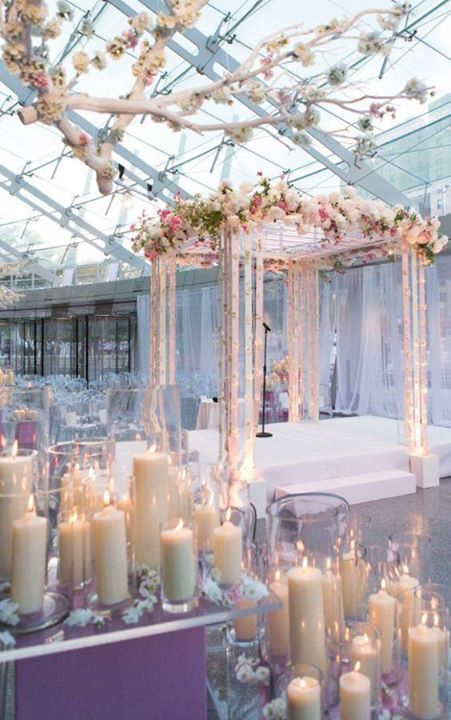 Ghost chairs and plenty of candles can be seen at this white and soft pink wedding ceremony ~ http://www.modwedding.com/galleries/wedding-ceremony-decor/