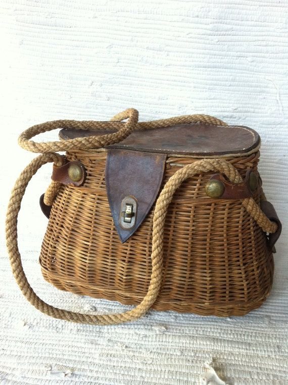 beautiful antique wicker fishing basket. You can use it for a summer purse, a picnic basket, or you can actually use it to fish if you want.