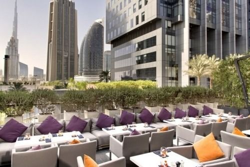 Outdoor dining chairs and tables by MANUTTI - exclusive Belgian outdoor furniture. Roof terrace Roberto's restaurant in Dubai.