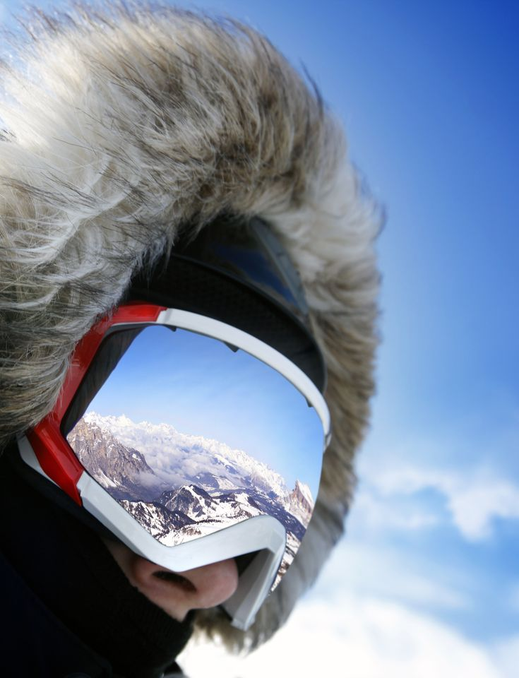 On top! brilliant - the summit reflected in the goggle lens