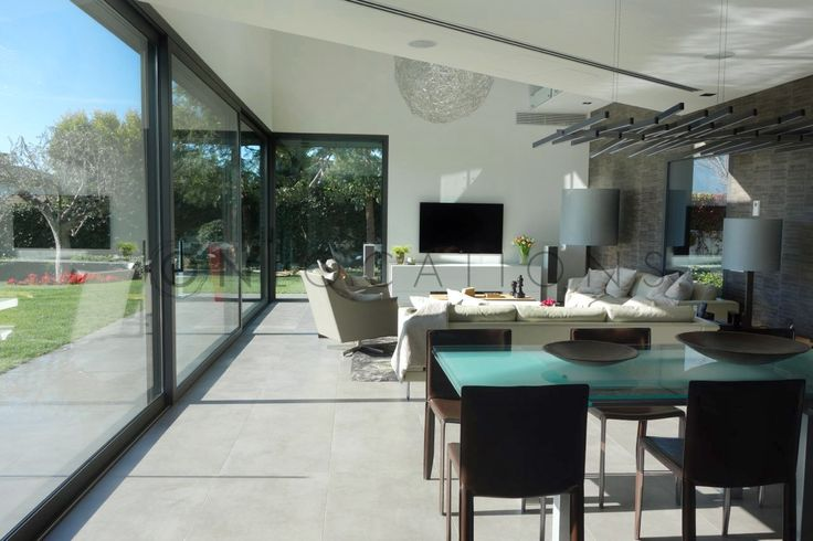 Spacious living room with large glass windows to the garden