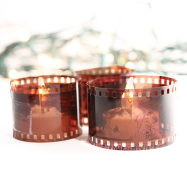 These would be cute for a photo-loving or photo-taking couple. -- Recycled film roll candle holder at Know and Tell Crafts -- I would definitely recommend wrapping the film around glass or using battery operated candles though.