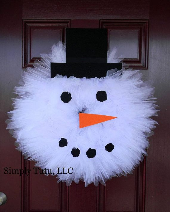 This wreath is the perfect addition to any door or entryway! Add a little whimsy to your home with our snowman wreath made with loads of white matte