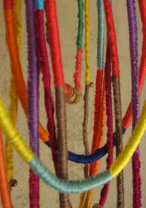 "Wrapped ""friendship necklaces"" with embroidery thread wrapped over twine - easier than"