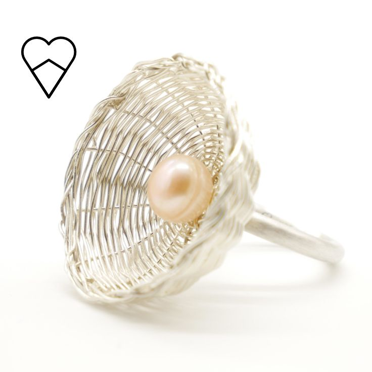 Woven silver and pink button pearl basket ring.