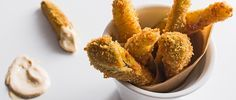 Unlike the fried pickles you've probably seen, which are typically in coin form, ours are dill spears that are coated in egg, panko and flour. Get the recipe.
