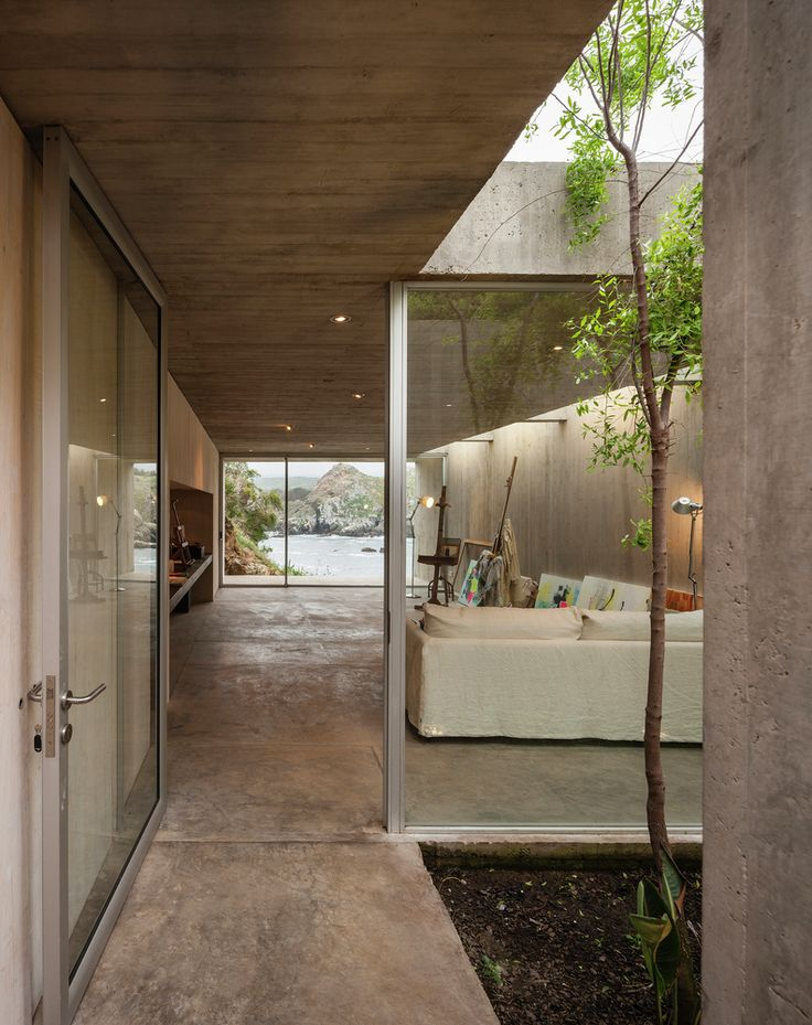 I love how this compact project is nestled into the hillside. The materiality and texture is beautiful,