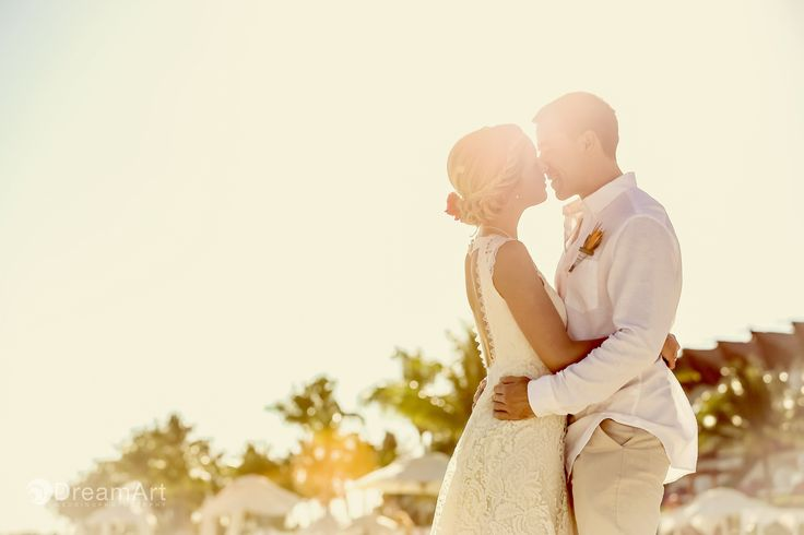 Bride and groom share a loving kiss during their wedding photo session at @gvrivieramaya in the Mayan Riviera, Mexico. Photo courtesy of #DreamArtPhotography.