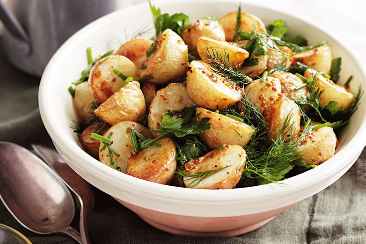 With its combination of crispy roasted potatoes and zingy fresh herbs, this potato salad is perfect for a summer barbecue or picnic.