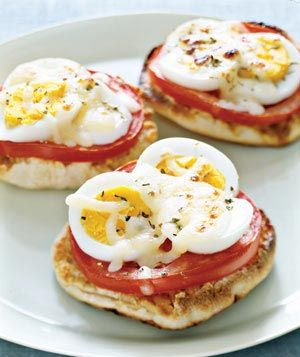 oh, good morning. toasted english muffins, drizzled with olive oil, layered with tomato slices and hard-boiled egg slices, topped with some mozzarella and salt