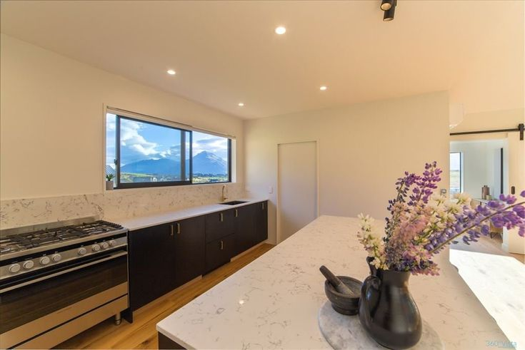 Falconer Rise, Jacks Point - Deavoll Construction | Queenstown Builders,  interior, design, architecture, kitchen, stove, wooden floor board,