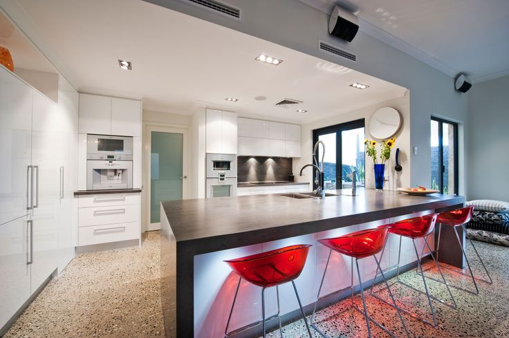 Beautiful Lava rock Corian® kitchen benchtop with integrated sink. #seamless #kitchen #kitchenbenchtop #sink #corian #drawers #cabinets #barstools By:Ikal Kitchens