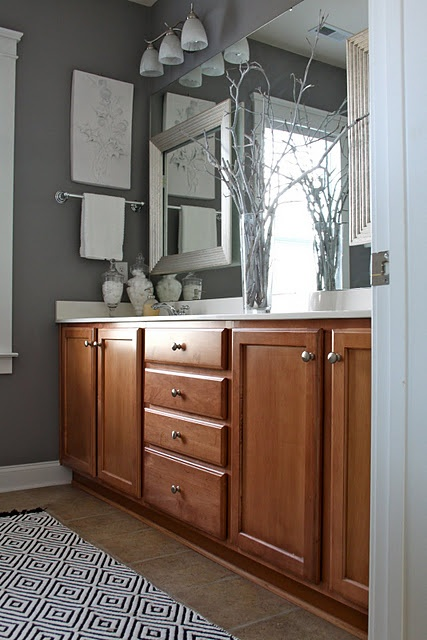 Grey bathroom ideas -- also, ways to make the giant contractor mirrors a little more eye-pleasing and a little less giant