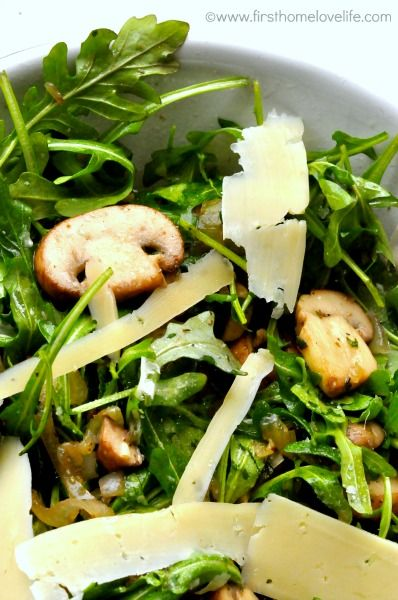 Earthy herbed mushrooms mixed with baby arugula, tossed in a light lemon vinaigrette, and topped with long paper thin shavings of salty Parmesan. This makes getting bored of eating salad almost impossible!   Caesar, Greek, blue cheese wedge…I'm always looking for new salads to m...