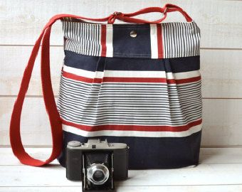 Navy white diaper bag,nappy bag,cotton diaper bag ,chic, large, roomy,VERSATILE Ikabags pleated Messenger bag, BEACH BAG,diaper bag,pretty library bag or weekender for women.With oeko text certified cross-body ddjustable strap..Made of best quality and WATER PROOF 100% cotton canvas fabric.Please read and choose your adjustable strap color at drop menu.STOCKHOLM messenger makes a great bag for everything .This relaxed style looks great worn across the body.Its stylish feminine design and…