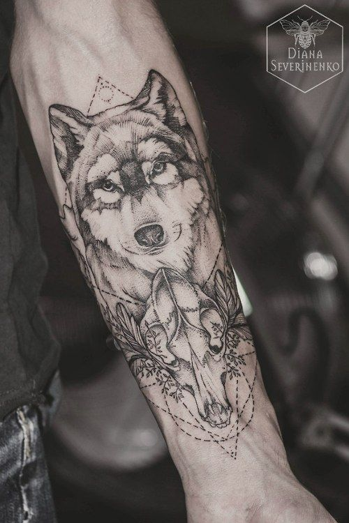 Cool wolf face, seems like dotwork. Love the wolf skull. Considering the implementation of geometric shapes.