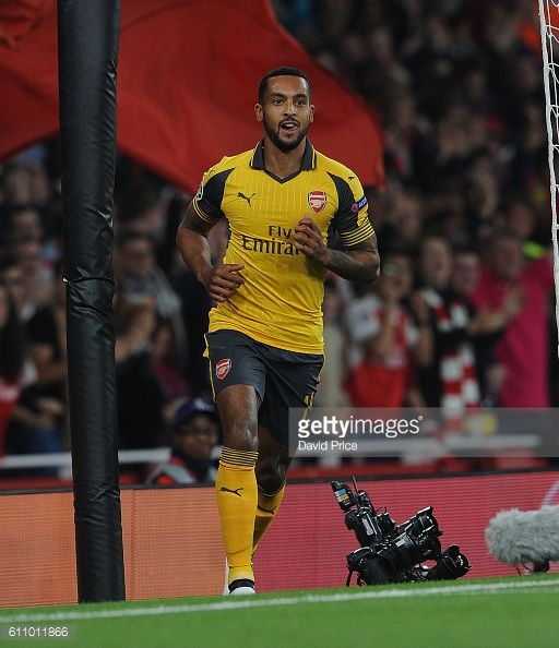 Theo Walcott celebrates scoring his and Arsenal's 1st goal during the UEFA Champions League match between Arsenal FC and FC Basel 1893 at Emirates...