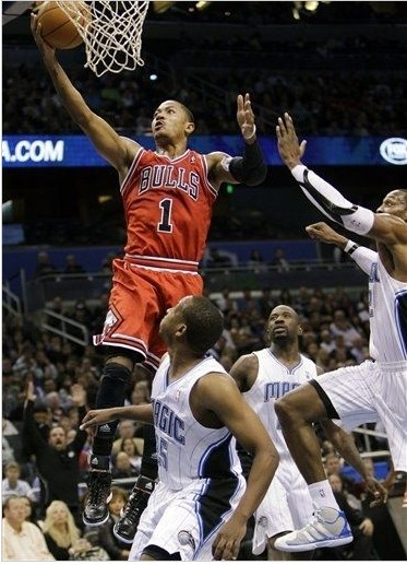 Derrick Rose of the Chicago Bulls lays up against the Orlando Magic. January 6, 2012