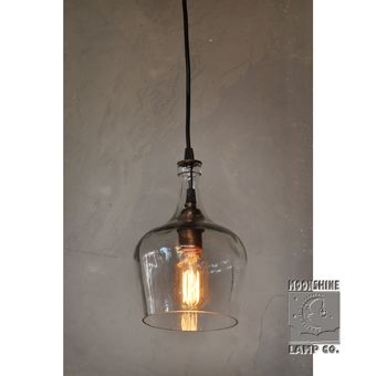 Found this amazing bottle that reminds us of an old world European water jug.  We can cut the bottom off of any of your favorite glass vessels and turn them into light fixtures. Visit us at moonshinelamp.com for more info.
