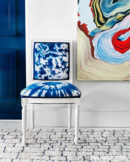 Swirls of vibrant color in a painting by Henrique Oliveira energize a wall.