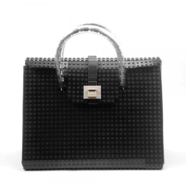 This black AGABAG tote is a chic choice for everyday use. It is handcrafted with LEGO bricks. Its interior is generously proportioned to fit all of your daily essentials, including an iPad and work documents.