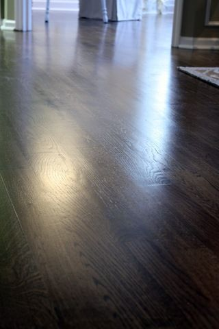 Use satin polyurethane to keep footprints and smudges from showing on the stained floor.