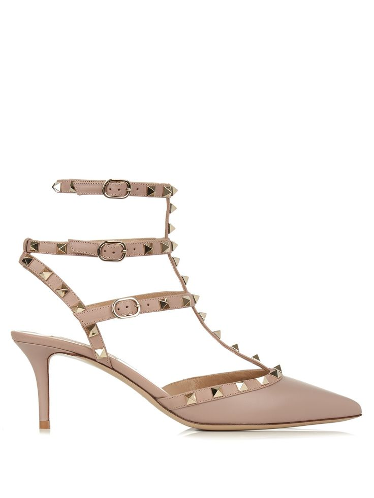 How best to balance this season's wide-leg jeans and fluid midi skirts? With delicate heels like Valentino's lilac-pink calf-leather Rockstud pumps. They have a T-bar silhouette that ends in a pointed toe, and is speckled with the iconic platinum-finish light gold-tone Rockstuds. Highlight them to best effect with ankle-grazing separates.