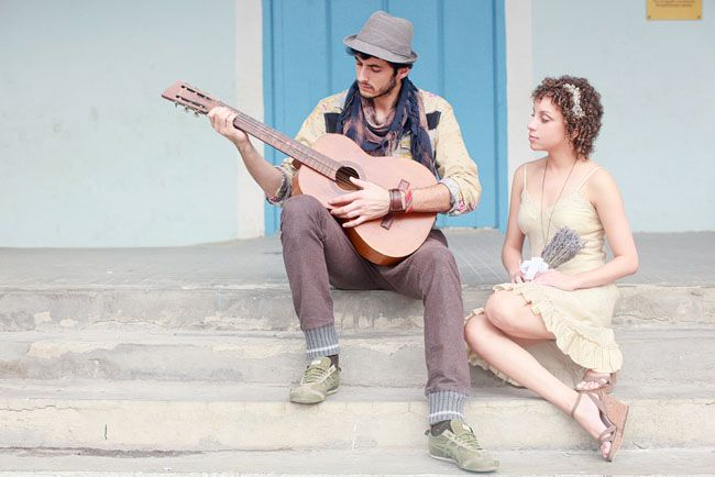 guy playing guitar for engagement shoot - wow