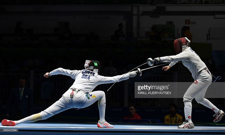 Brazil's Rayssa Costa (L) competes against Switzerland's Tiffany Geroudet during their womens individual epee qualifying bout as part of the fencing event of the Rio 2016 Olympic Games, on August 6, 2016, at the Carioca Arena 3, in Rio de Janeiro. / AFP / Kirill KUDRYAVTSEV