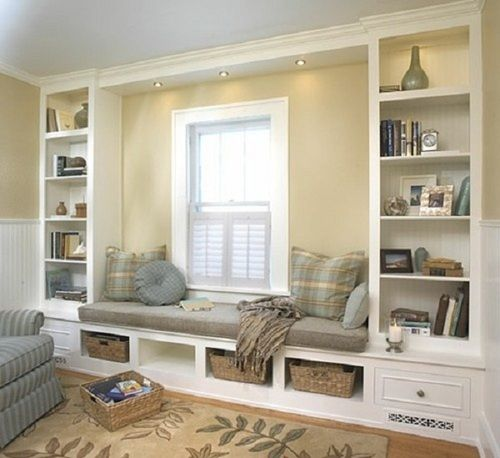 What a great use of space. It adds seating, storage, organization and charm! Reading nook / window seat