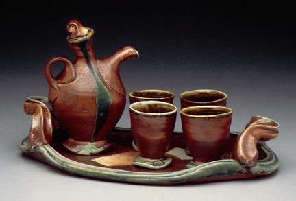 Wood Soda Fired Porcelain Liquor Set - i like the very circular handle on an otherwise tilted-feeling vessel