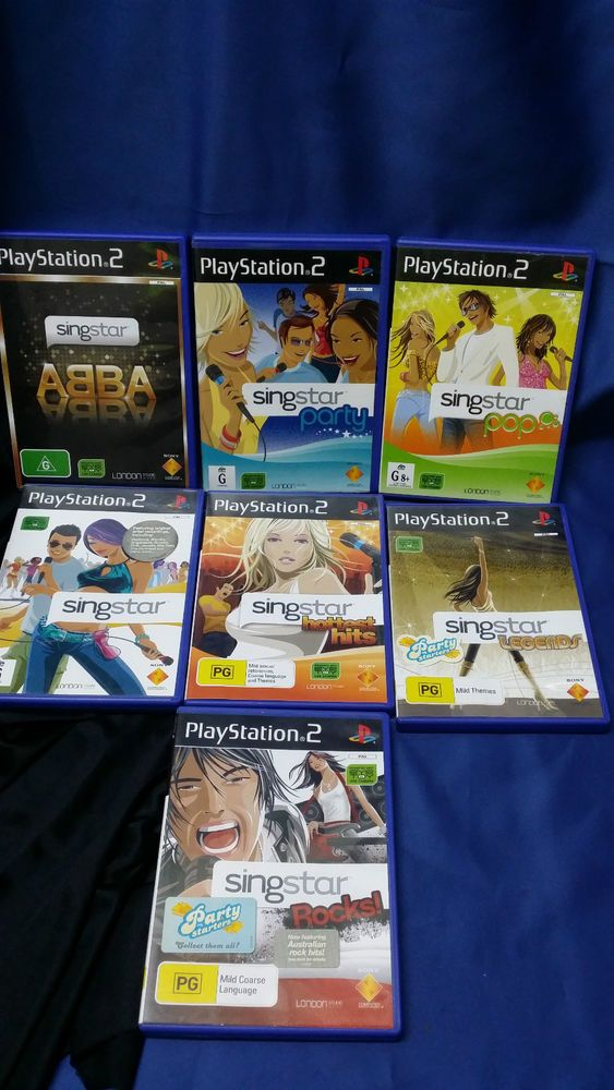 PLAYSTATION 2 SINGSTAR GAMES & 2 MICROPHONES **CHARITY AUCTION**
