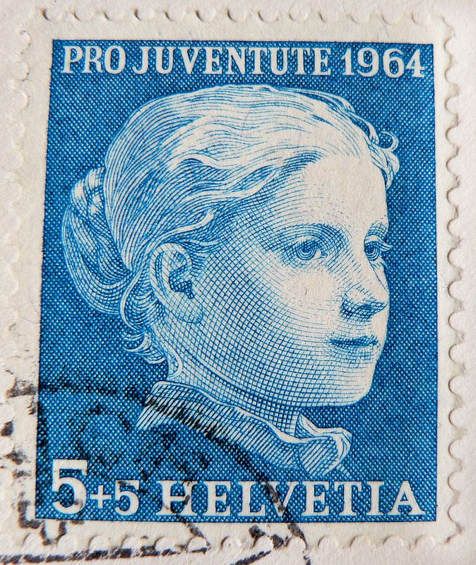 Swiss stamp. Helvetia 5+5 Rappen/cent. charity stamp (painting by Albert Anker 1831-1910 / portrait of a girl)