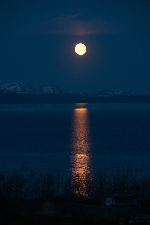 A full moon rises over Lake Iliamna in early summer.