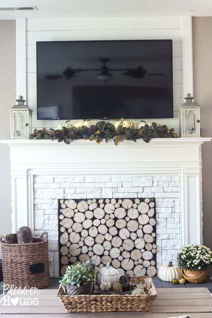 Hide cords, cable boxes, and DVD players with leafy garland for a pretty but functional mantel.