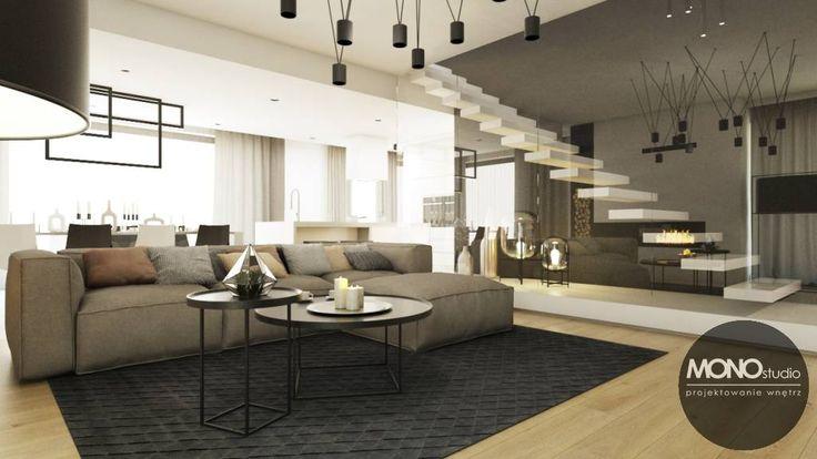 Owarte przestrzenie salonu i kuchni optycznie zwiększają wnętrze a połączenie kolorów beżowych, białych i ciemnych nadaje mu ciepłego i przytulnego klimatu. Po więcej inspiracji zapraszamy na naszą stronę: http://monostudio.pl/ oraz na Facebooka