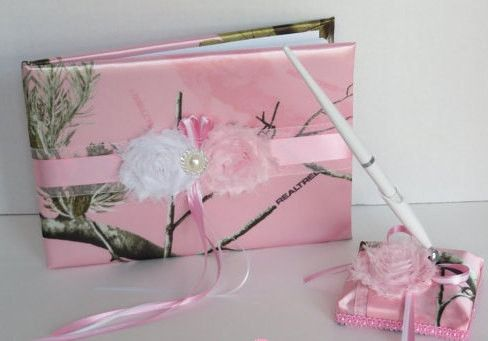 This sporty guest book and pen set is perfect for the modern outdoorsy bride. It is made with Soft Pink Realtree AP Satin Camo print and soft pink and white shabby chic flowers, pearl brooch and match