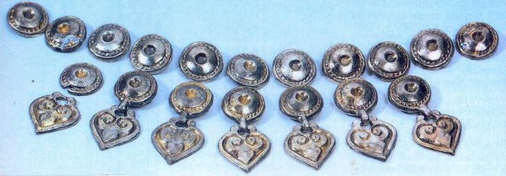Xth century Magyar female caftan fittings made of silver. Two pieces, one is hanging. Site Sárrétudvarhely. (2)